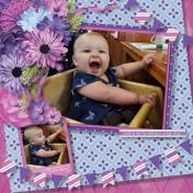 Baby Maya sitting in a High chair